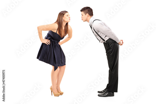 Full length portrait of a heterosexual couple about to kiss