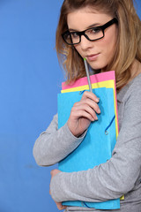Teenage girl with folders