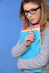 Teenage girl with folders