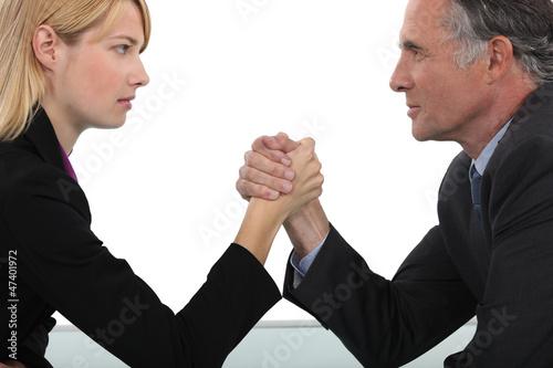 Boss and employee having an arm wrestle