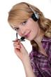 Receptionist wearing telephone head-set