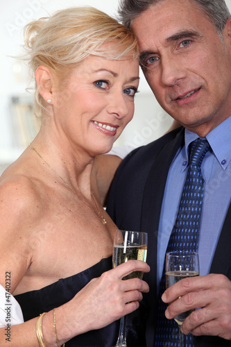 Mature couple with glasses of champagne
