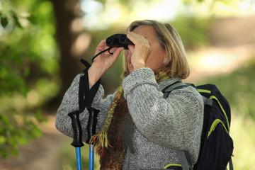 senior woman on a mountain hike