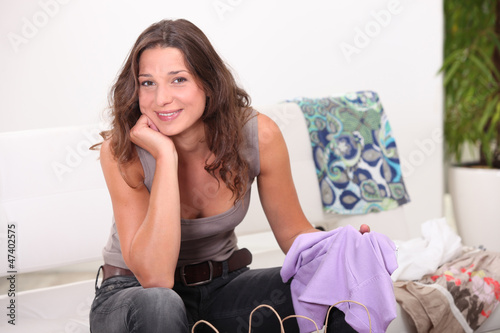 Girl pulling clothes bags