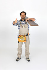 Man carrying laminate flooring on shoulder