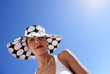 Portrait of woman with hat by summertime