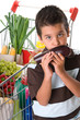 Little child smelling eggplant