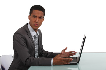Anxious businessman in front of computer