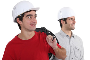 Tradesmen looking sideways