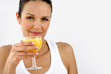 Woman having refreshing glass of orange juice