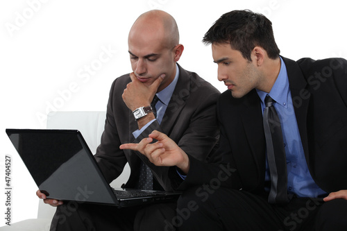 Two businessmen exchanging thoughts