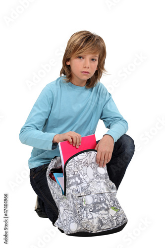 Boy packing school bag