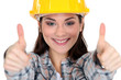 Thumbs up from a female construction worker