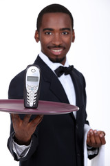 Waiter with a cellphone on a tray