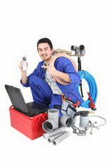 Plumber with laptop, cellphone and materials