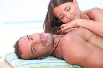 young affectionate couple resting at beach