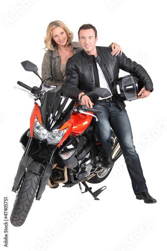 Biker chic with hand on biker's shoulder.