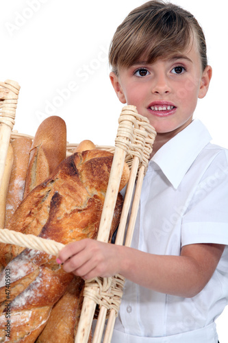 Little girl with basket of bread