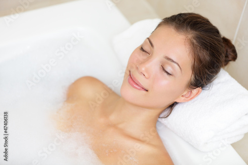 Bathing woman relaxing in bath