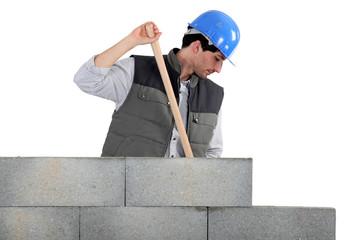 bricklayer near concrete wall