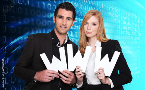 Couple holding WWW letters