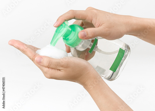 woman pressing the liquid soap to her hand.