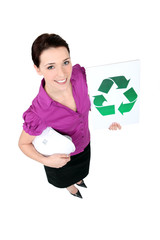 Businesswoman holding a recycling label