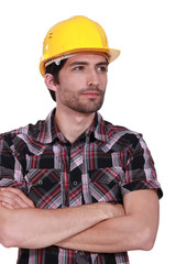 handsome craftsman with safety helmet