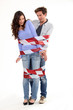 couple tied together with red and white tape
