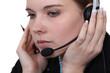 beautiful businesswoman wearing headset