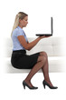 Blond businesswoman chatting via the Internet
