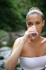 Brunette drinking glass of water