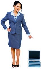 Smiling businesswoman pointing towards laptops