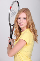 Girl with tennis racket