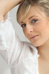 Pretty blonde in a white blouse