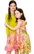 Smiling girls hugging eachother
