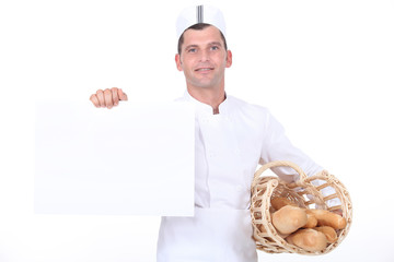 A baker holding a white poster.