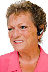 Happy woman wearing bluetooth