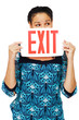Close-up of a woman holding exit sign