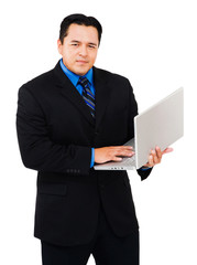 Portrait of businessman working on laptop