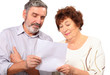 Senior couple hold paper list in hands, isolated