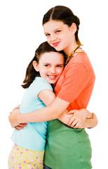 Close-up of girls hugging