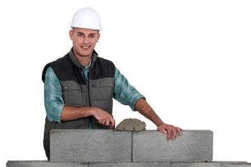 Bricklayer constructing wall