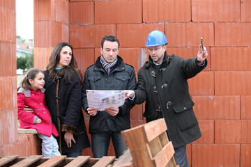 Family being shown around construction site