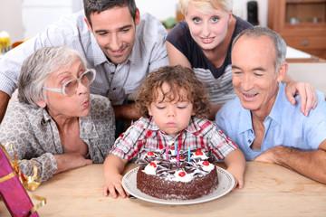 Family celebrating birthday boy