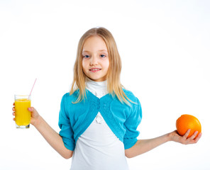 Happy smiling girl with fruits and juice