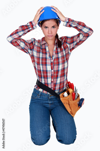 Stressed female builder