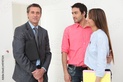 Couple meeting with a real estate realtor