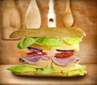 Sandwich on old vintage wooden boards abstract concept