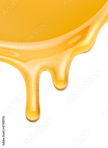 honey flowing on a white background